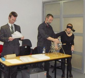The Australian Electoral Commission holding a blind ballot to determine the order of candidates on the ballot paper, 2004 Ac.ballotdraw.jpg