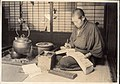 Accounting in Japan, Taisho era - Man with an Abacus and an Account Book, beside Irori (1914 by Elstner Hilton).jpg