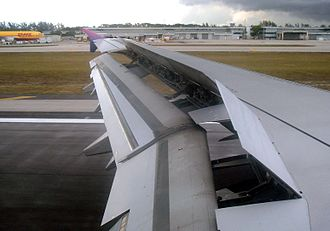 Spoiler (aeronautics) - A close look at the spoiler (the parts of the wing that are raised up) during the landing of an Airbus A321.