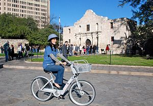 San Antonio B-Cycle - Customer riding the bike in front of the Alamo in downtown San Antonio.