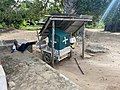 Ambulance and it's driver resting nearby. Chole island, Tanzania.jpg