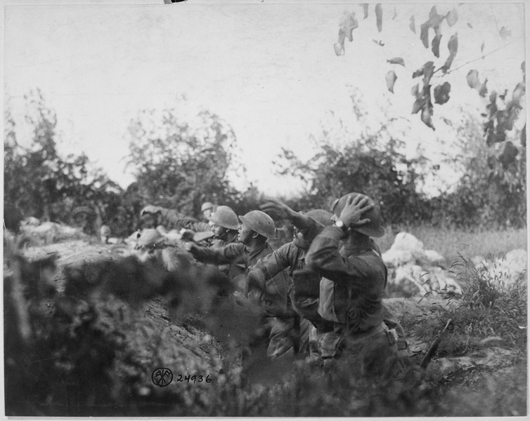 File:American soldiers on the Piave front hurling a shower of hand grenades into the Austrian trenches. Varage, Italy.... - NARA - 530761.tif