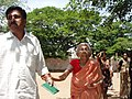 An aged lady is escorted to a polling booth to cast her vote at a polling station of Madurai West Assembly Constituency (by-election), Tamilnadu on June 26, 2007.jpg