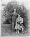 An unidentified man and woman, photographed in a garden ATLIB 314035.png