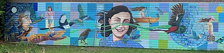 Byron Gómez Chavarría, Mural of Anne Frank with birds and hand prints of children (2017), Anne Frankschool, Utrecht, the Netherlands, 2020