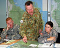 Australian Defence Force Lt. Col. Eric Stevenson, center, the joint and combined umpire liaison officer to Forces Command, orients U.S. Army Lt. Brandon Thomann, left, a scout cavalry officer assigned to the 110616-A-NU174-003.jpg