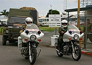 Australian Army Land Rover and two Military Police motorcycles