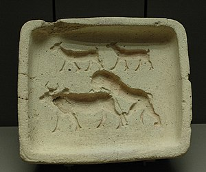 Baking - A terracotta baking mould for pastry or bread, representing goats and a lion attacking a cow. Early 2nd millennium BC, Royal palace at Mari, Syria