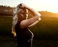 Blond woman in black clothing in a field by sunset.jpg