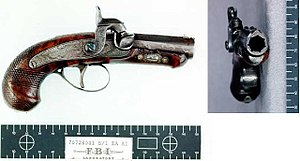 Percussion cap - Single-shot caplock pistol used to assassinate Abraham Lincoln. This type of small handgun is known as a Derringer.