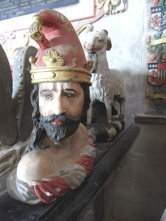 William Bourchier, 3rd Earl of Bath - Heraldic footrests on monument to William Bourchier, 3rd Earl of Bath (died 1623), Tawstock Church. The figures represent the crests of Bourchier and of Russell, his wife Elizabeth's family: Bourchier: A man's head in profile proper ducally crowned or with a pointed cap gules; Russell: A goat statant argent armed and unguled or