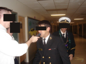 Sobriety - A midshipman is subjected to a random breathalyzer test to see if he is sober or not.