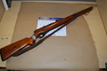 Brown .22 caliber Mossberg rifle recovered by DC Metro Police.png