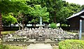 Buddha statue with votive offerings. Banna-ji. Ashikaga.jpg