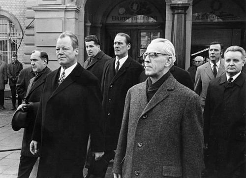 Willy Brandt (left) and Willi Stoph in Erfurt 1970, the first encounter of a Federal Chancellor with his East German counterpart, an early step in the de-escalation of the Cold War Bundesarchiv B 145 Bild-F031406-0017, Erfurt, Treffen Willy Brandt mit Willi Stoph.jpg