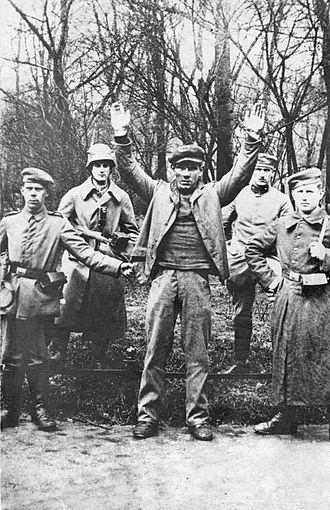 Political violence in Germany (1918–33) - Soldiers posing with a captured revolutionary, May 1919