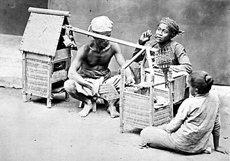 Street food - Satay street vendor in Java, Dutch East Indies, c. 1870, using pikulan or carrying baskets using a rod.
