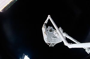 Science and technology in Canada - The Canadian-built space station robotic arm (right), referred to as Canadarm2, transferred its launch cradle over to Endeavour's Canadian-built robotic arm, referred to as Canadarm