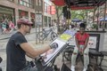 Caricaturist Ben Bloss draws a sketch of Shanice Harris in the mile-long 16th Street pedestrian mall in downtown Denver, Colorado LCCN2015633449.tif
