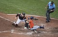 Catcher Caleb Joseph, José Altuve out at home plate, umpire Mike Winters.jpg