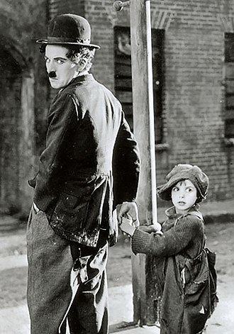 The Kid (1921 film) - Chaplin, at left, wrote, produced, directed, edited, and starred in the film, and later went on to compose the music score as well.