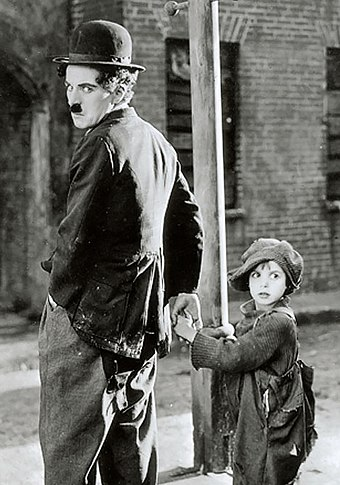 The Kid (1921), with Jackie Coogan, combined comedy with drama and was Chaplin's first film to exceed an hour. Chaplin The Kid 2 crop.jpg