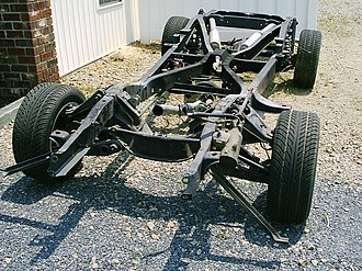 Chassis - Motor vehicle chassis with its suspension, exhaust system, and steering box