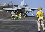 Chief Warrant Officer observes F-A-18C Hornet Take-Off DVIDS63786.jpg