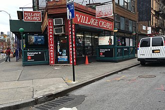 Hess triangle - Location of the triangle, outside the Village Cigars shop and the Christopher Street station of the New York City Subway. The triangle can be seen on the sidewalk toward the left side of the photo.