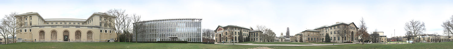 "A panoramic view of Carnegie Mellon University's Pittsburgh campus from the College of Fine Arts Lawn.From left to right: College of Fine Arts, Hunt Library, Baker and Porter Hall, Hamerschlag Hall, University of Pittsburgh's Cathedral of Learning (in the background), Wean Hall and Doherty Hall, Purnell Center, and the Cohon University Center. Also visible are ""The Fence,"" and the ""Walking to the Sky"" sculpture."
