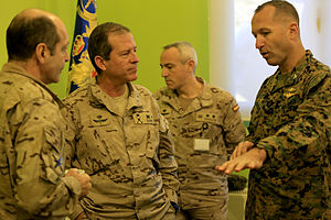 24th Marine Expeditionary Unit - Col. Scott F. Benedict, right, talks with Spanish aviation leaders during a visit to Madrid, Spain in November 2013.