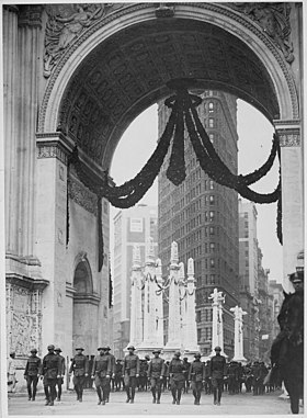 A 1919 image of the 165th Infantry Regiment passing through Madison Square's Victory Arch. The Flatiron Building is in the background.