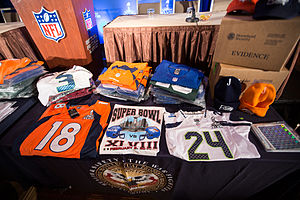 National Intellectual Property Rights Coordination Center - Counterfeit NFL merchandise on display at an NIPRCC press conference