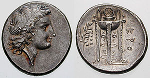 Sacrificial tripod - An ancient Greek coin c. 330-300 BC. Laureate head of Apollo (left) and ornate tripod (right).