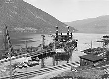 Historic photo of the ferry preparing to cross Lake Tinn.
