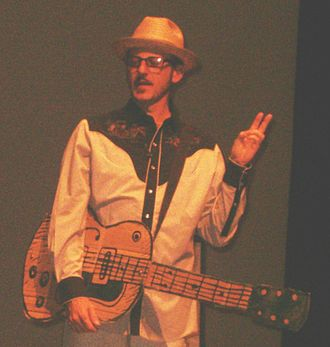 Dan Piraro - Dan Piraro with a cardboard guitar at NAVS Vegetarian Summerfest 2006