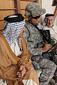 Defense.gov News Photo 100513-A-7879C-086 - U.S. Army Sgt. Derek Hahn with the 341st Tactical Psychological Operations Company 17th Fires Brigade gathers information on the security within.jpg