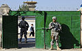 Defense.gov News Photo 101106-F-2185F-023 - U.S. Army Pfcs. Nicholas Sudano right and Nicholas Querzoli both assigned to the Zabul Provincial Reconstruction Team secure the gate to the.jpg