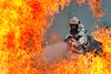 Defense.gov News Photo 120723-F-HA794-089 - A U.S. Air Force firefighter sprays water at the fire of a simulated C-130 Hercules plane crash during operational readiness exercise Beverly.jpg