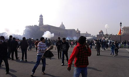 Police used water cannon and tear gas to attempt to break up the protestors. Delhi protests-teargassed.jpg