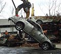 Demolition grabbing a burned car to haul away.JPG