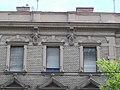 Deutsch house (1888). Human heads. - 37 Erzsébet Boulevard, Budapest.JPG