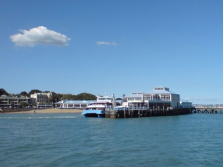 Ferry travel is a common type of public transport for some Auckland destinations Devonport Wharf Kea Ferry.jpg