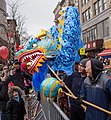 Dragon dance meets bird at NYC Lunar New Year parade (52336).jpg