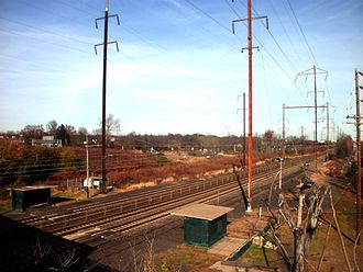 Eddington station - The station as seen from the bridge over the Northeast Corridor / Trenton Line along Street Road. Interstate 95 is visible in the distance.
