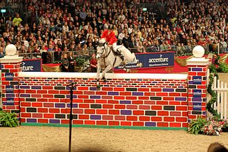 Olympia London International Horse Show - Ellen Whitaker with Ladina B at the Accenture puissance at 2008 Olympia London International Horse Show
