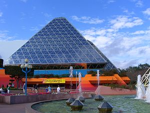 Epcot - Glass pyramids of Imagination! with the jumping fountains in the foreground