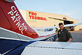 FEMA - 36494 - Civil Air Patrol pilot checks over his plane in Missouri.jpg