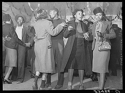 Dancing at a juke joint near Clarksdale, Mississippi, in 1939, by Marion Post Wolcott. FSA Dancing JukeJoint.jpg