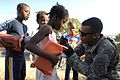 Flickr - The U.S. Army - Soldiers distribute aid in Haiti.jpg
